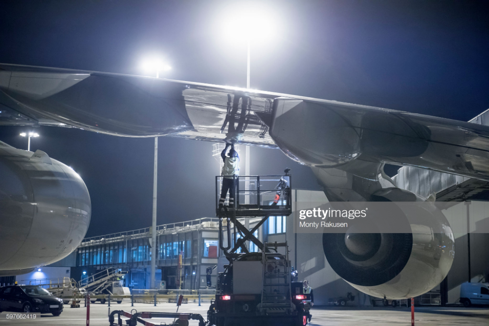 Ground Crew Member Refuelling A380 Aircraft At Night A380 Aircraft Aircraft Crew Members