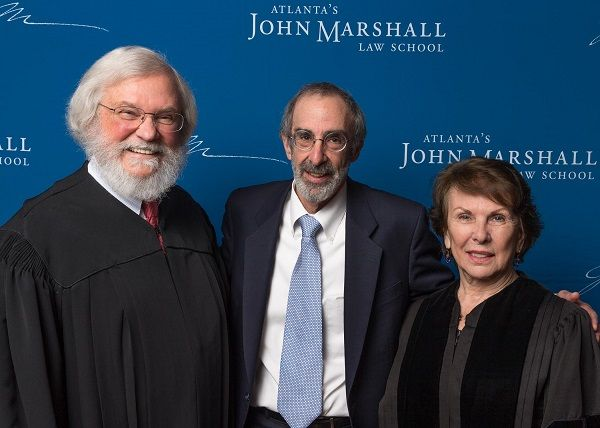 Judge T. Jackson Bedford, Dean Malcolm L. Morris and Justice Carol Hunstein pose together at the swearing in for #AJMLSAlumni.