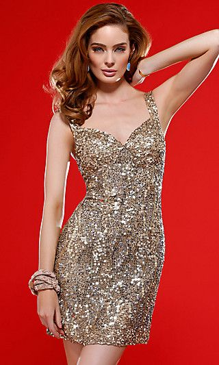 a76f31ec62 Sparkle from every angle in this short beaded dress by Scala. A ...