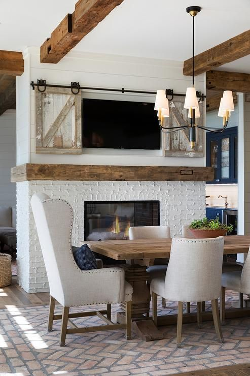 Farlane Large Chandelier Hangs From A Ceiling Accented With Rustic