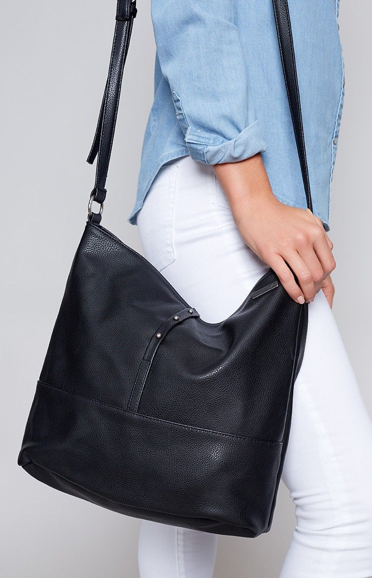ba46f9fa44 Sometimes when your outfit has already got it going on you just need a  simple black bag and the Rusty Dahlia Side Bag Black is ready for the job!