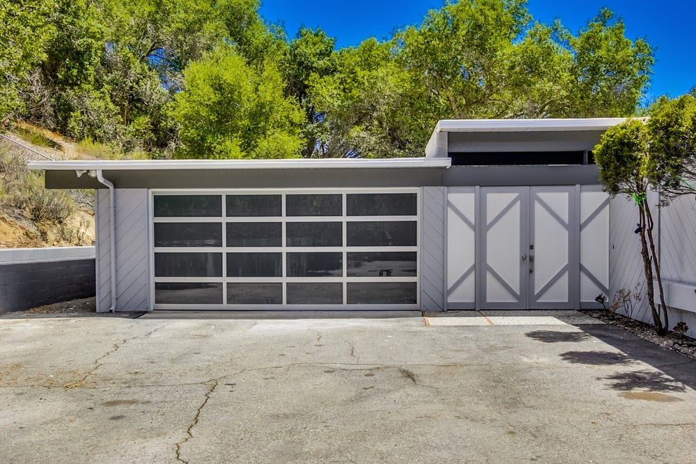 2096 Gird Road | Fallbrook, CA 92028 | San Diego Coastal Real Estate Simple, clean lines and gray and white monotone paint let you see the detail in the exterior of the home.