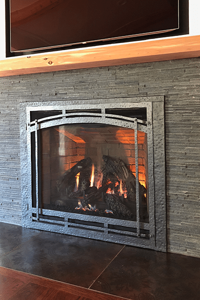 Custom Direct Vent Gas Fireplace With Tv Mounted Above Wood Beam