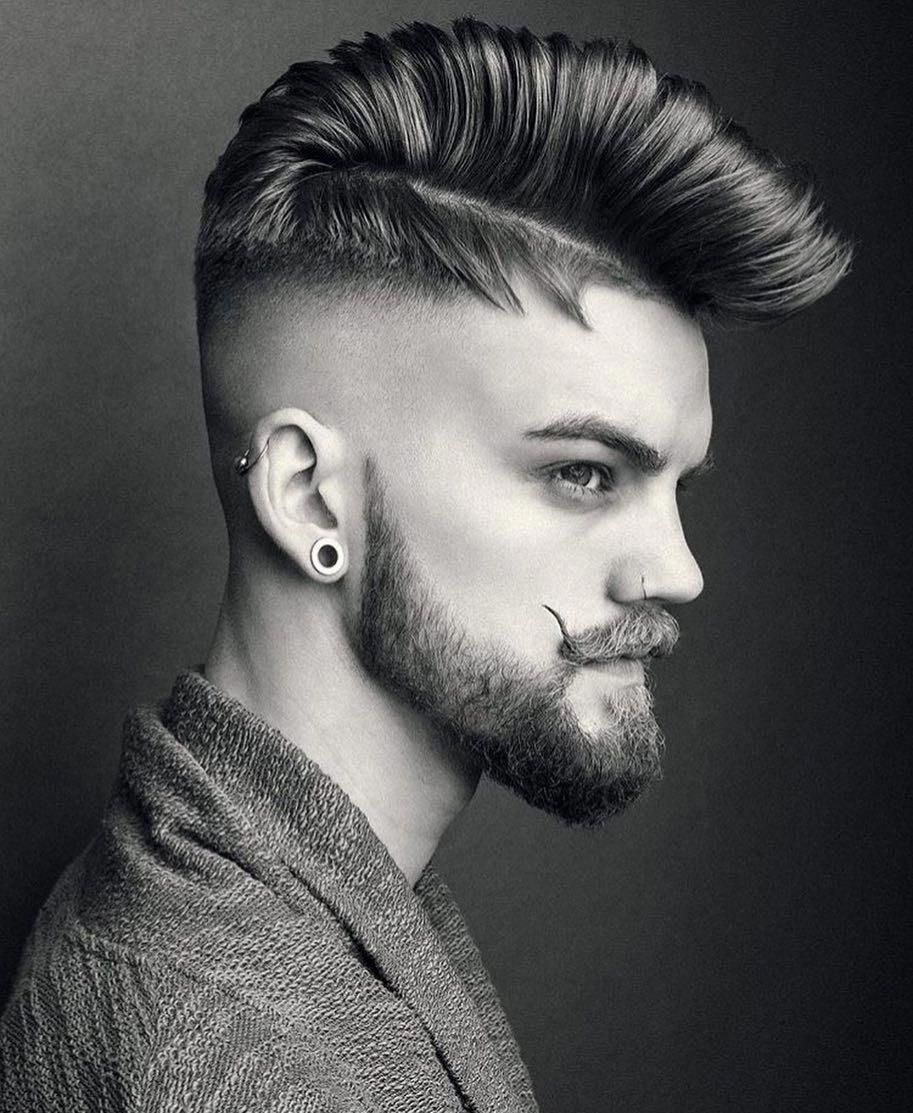 Rolled pomp over a disconnected step fade handlebar mustache