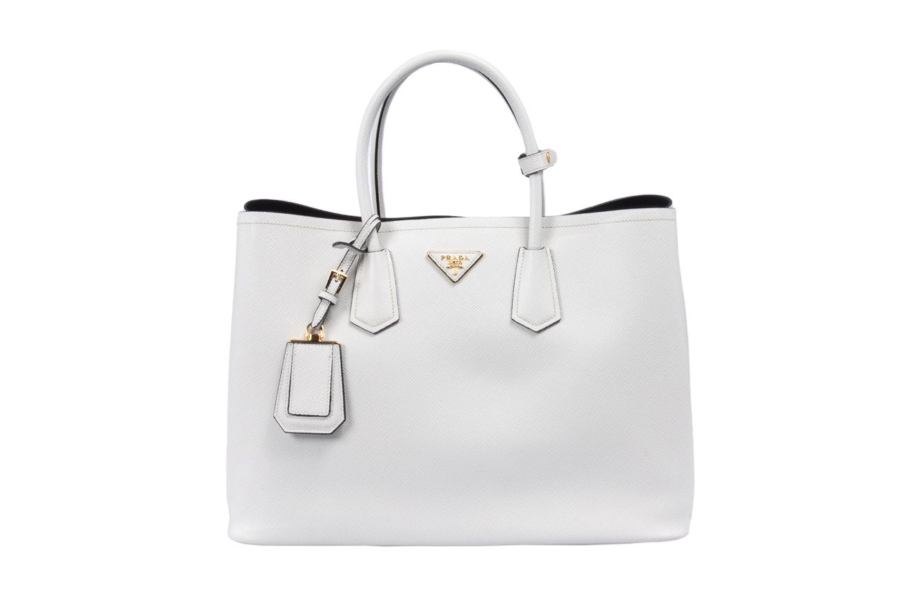 Made of saffiano leather it will arrive with authenticity tags and