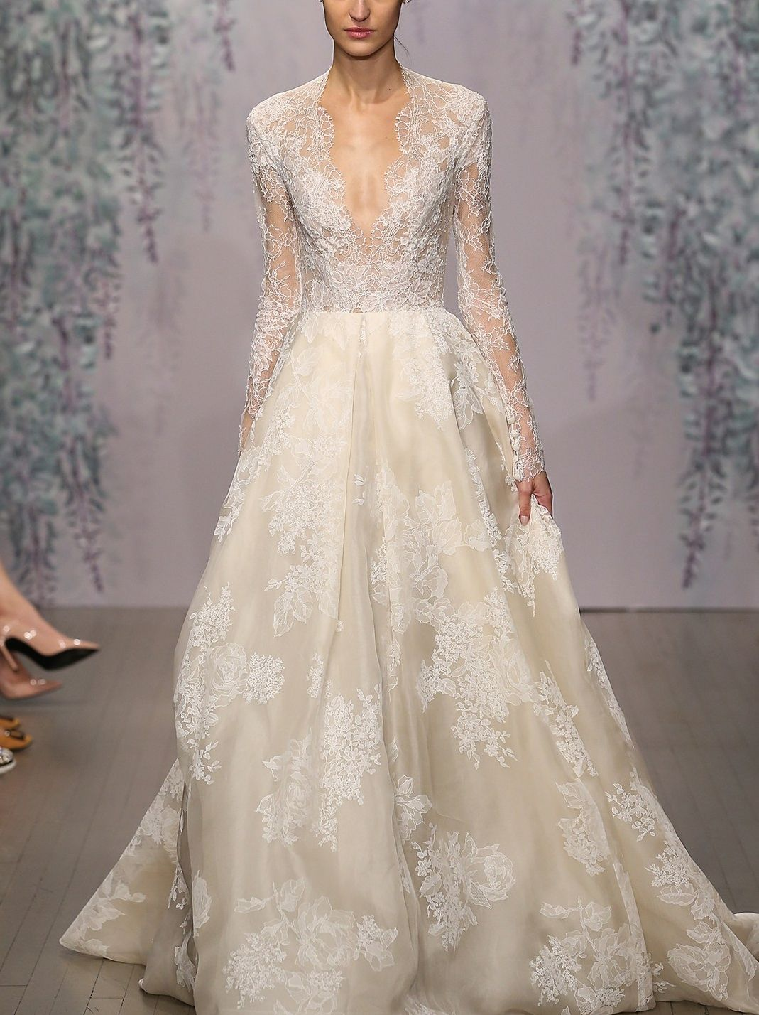 The iconic romance of a long-sleeve gown takes a modern, sultry tw ...