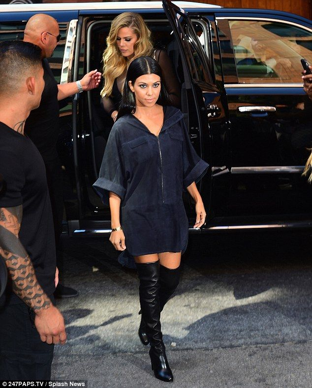 Arriving in style: The 38-year-old mother-of-three Kourtney rocked a black suede mini dres...