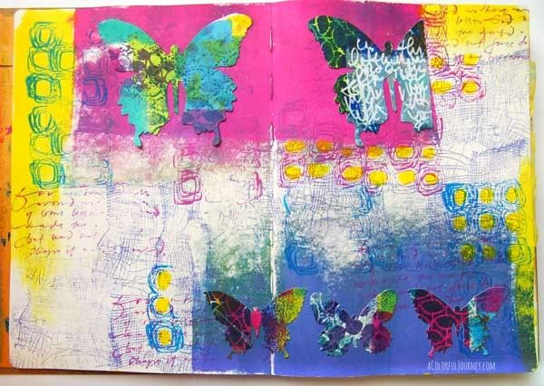 I made a messy paper with stencils then used them with a die cut to make a butterfly art journal page!