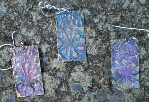 Earrings and pendant. Copper stamped and inked.