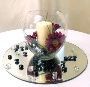 Delightful Glass Fish Bowl With Artificial Gerberas And Candle On Glass Mirror Plate