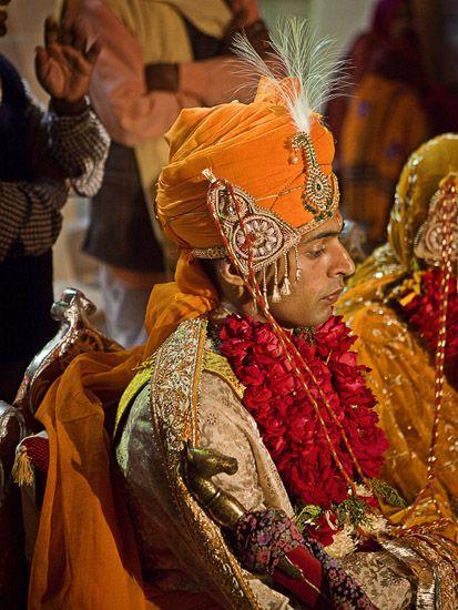 Beautiful saffron Indian wedding turban.
