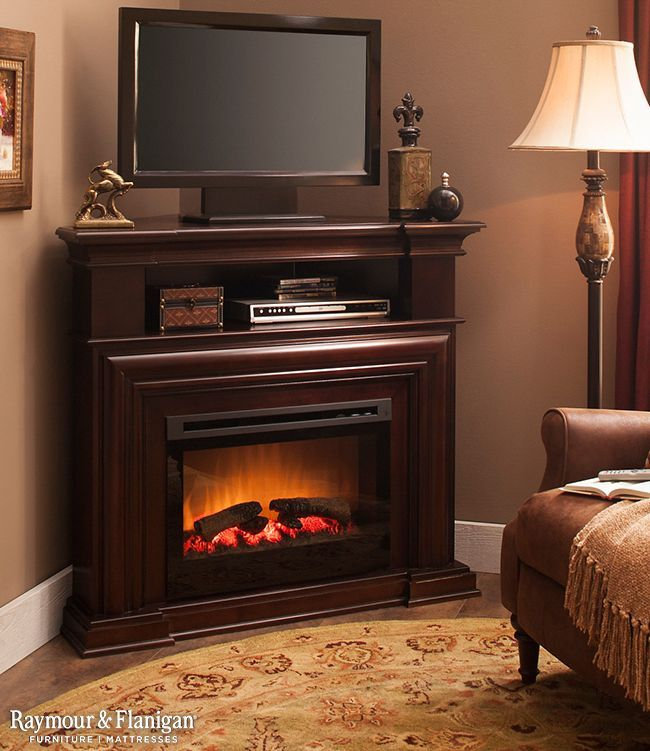 Cozy Up In The Corner Of Your Bedroom With A Warm Fireplace And A Chair.