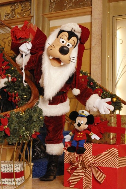 """From traditional Thanksgiving and Christmas feasts to """"snowflake"""" sightings, seasonal caroling and even a visit from Santa Goofy, the Holidays are more magical aboard Disney Cruise Line."""