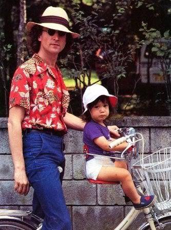 John and baby Sean stroll along Central Park