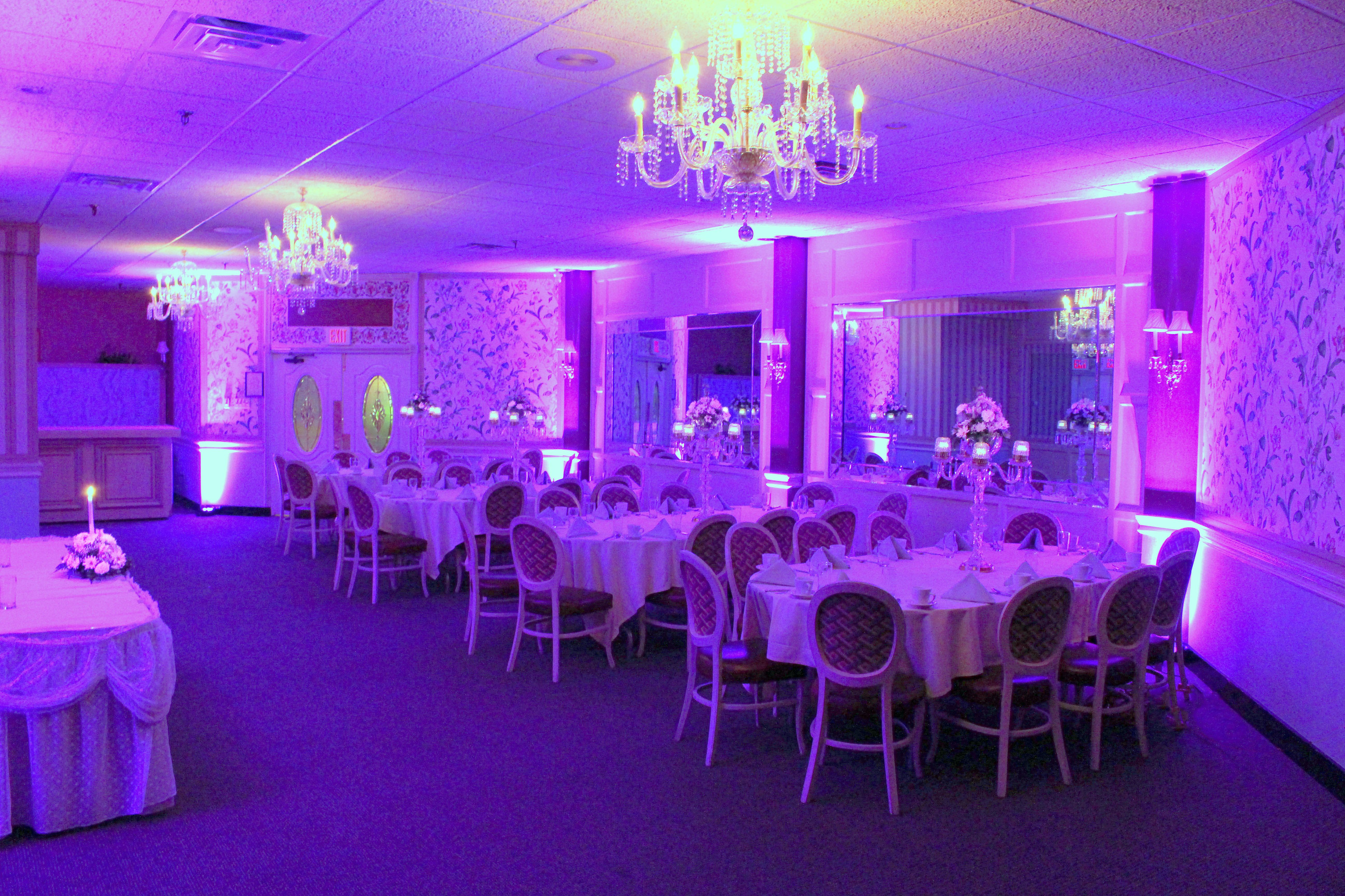 Sanctuary set for an Intimate Wedding with complimentary uplighting in the Bride's choice of color