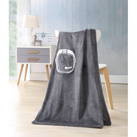 Blast off to Outer Space with the KiKi Astronaut Gray Throw Blanket. This 100% ultrasoft polyester blanket features an embroidered astronaut helmet perfect for your little space traveler. The perfect weight, but when not in use, this rolls up and secures with buttons to highlight the space helmet for added adventure and imagination. This throw is out of this world! Size: 50 inch x 60 inch.