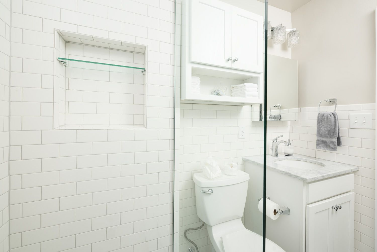 Broad Ripple Bungalow Bathroom: White and Chrome Finishes, Mirror ...