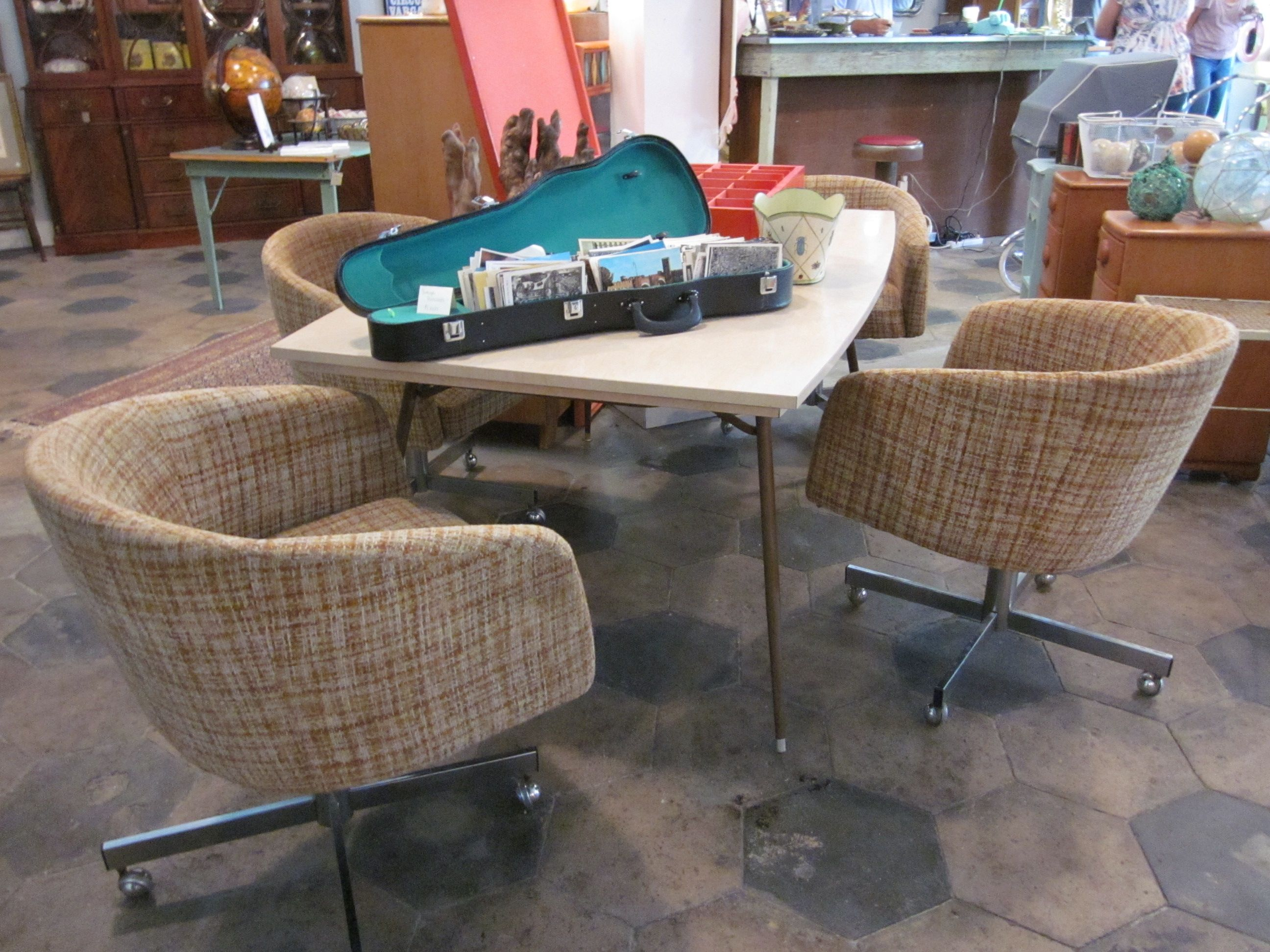 Mid Century Dining Table With Funky Rolling Chairs Sold