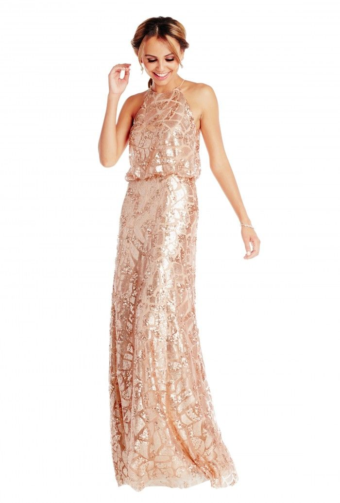 A floor-length sequin bridesmaid dress with a halter top, available ...