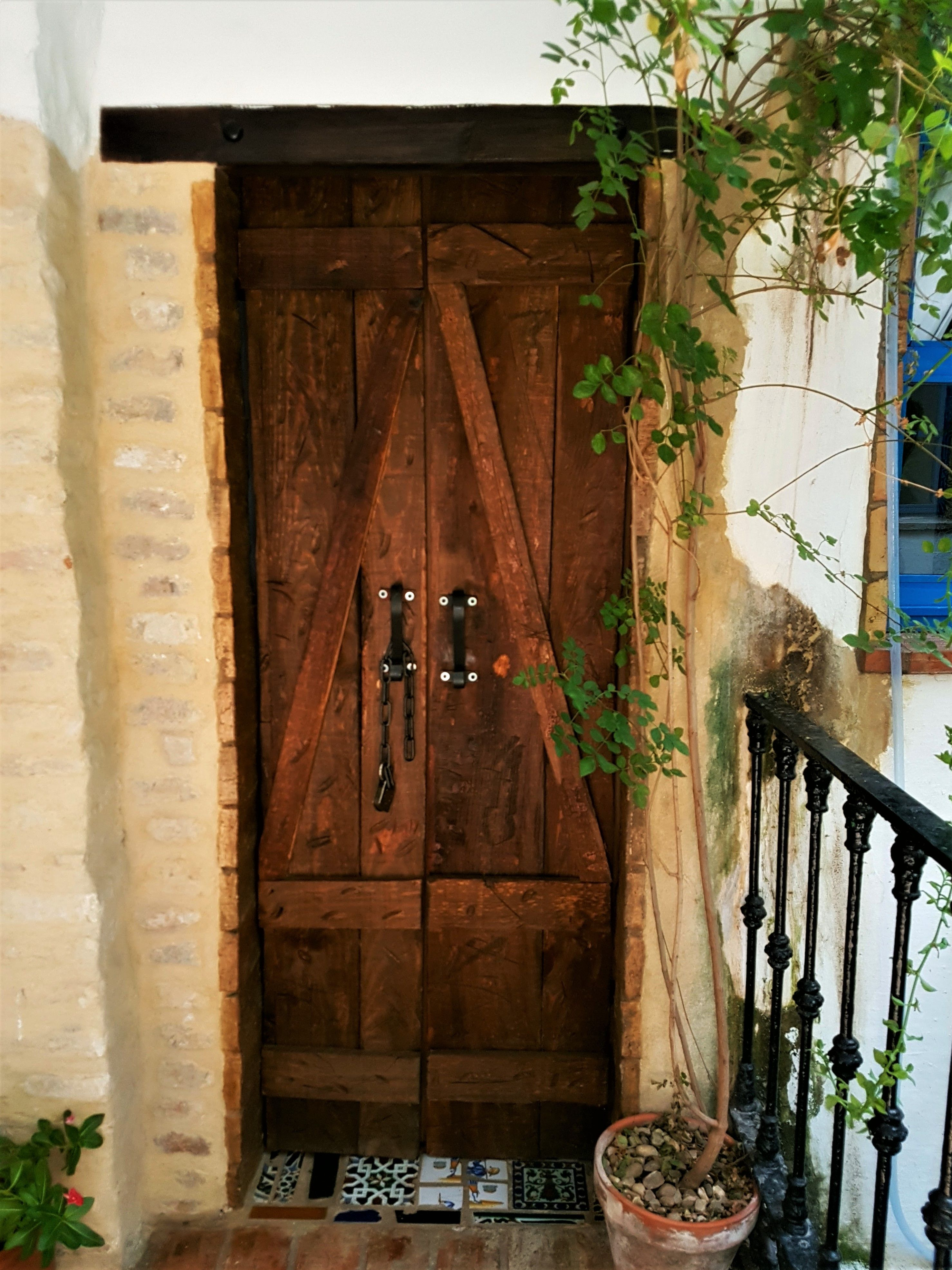 Unique Experience In Seville Sevilla Spain Vintage Rustic Antique Artisan Forged Gold Metal Lock With Forg Wood Doors Interior Rustic Wood Doors Wood Doors
