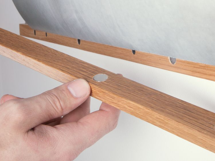 Magnets automatically align the frame, clamping art securely in between.