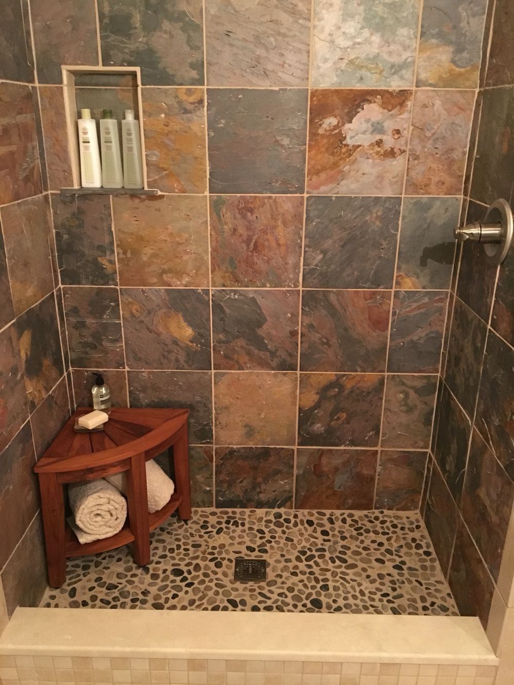 Small Shower With Slate And River Rock Tile And A Teak Bench