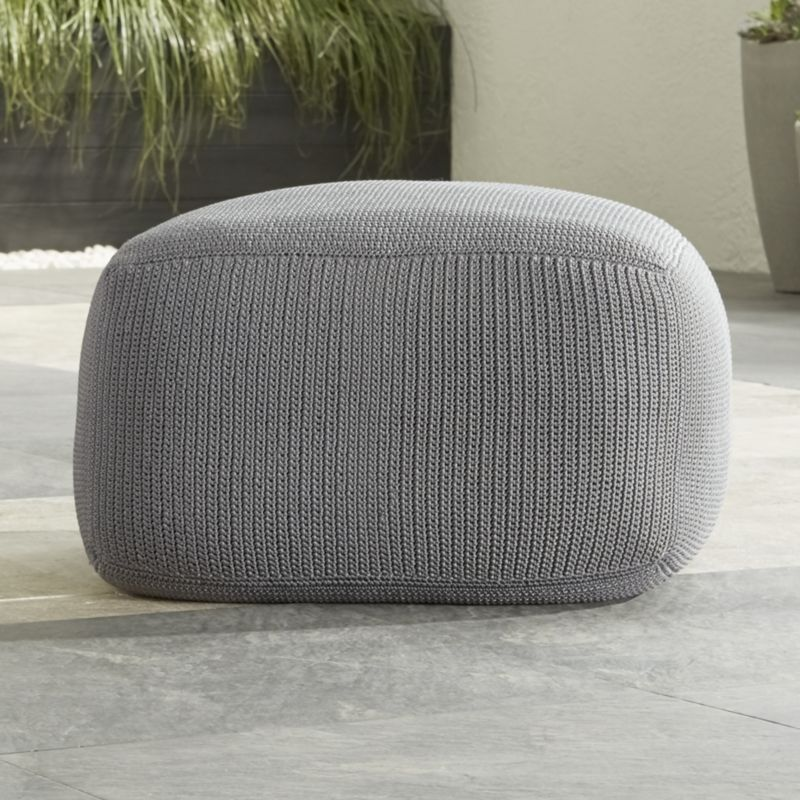 Weather-resistant polypropylene yarn knits up sweater-comfy in cool graphite as a plump, portable square outdoor pouf.  Perfect as an ottoman or extra seat, each pouf is crocheted by hand. HandcraftedPolypropylenePolyester taffeta insert with polystyrene bead fillZippered coverSpot clean or hand wash with mild soap and waterProtect from inclement weatherCover recommendedMade in Indonesia.