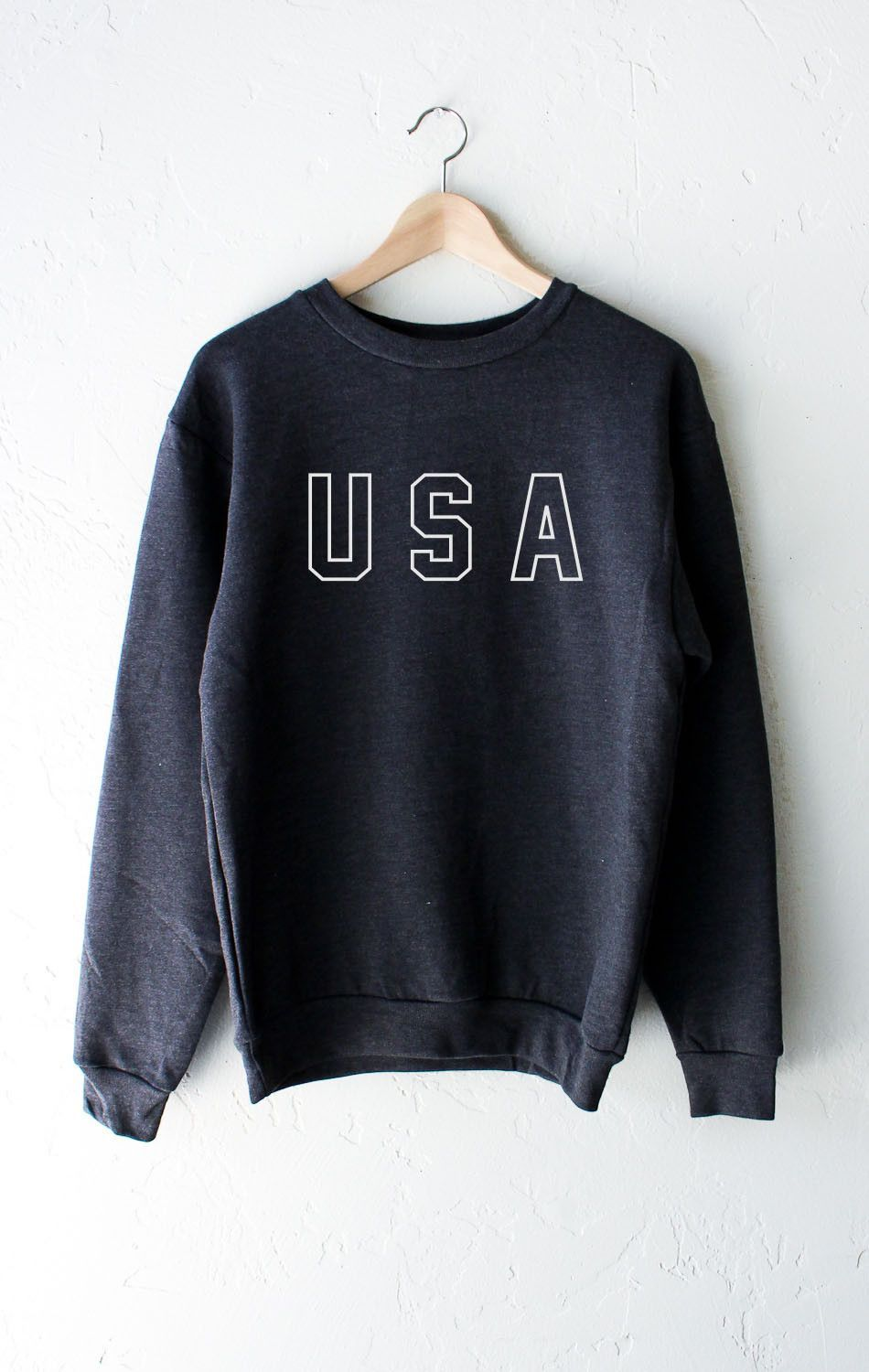 ea56b8a9f92 Description Details  Get cozy in our soft oversized dark heather grey  sweater with print  USA . Unisex