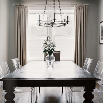 lucite dining room chairs with a heavy looking table makes the small