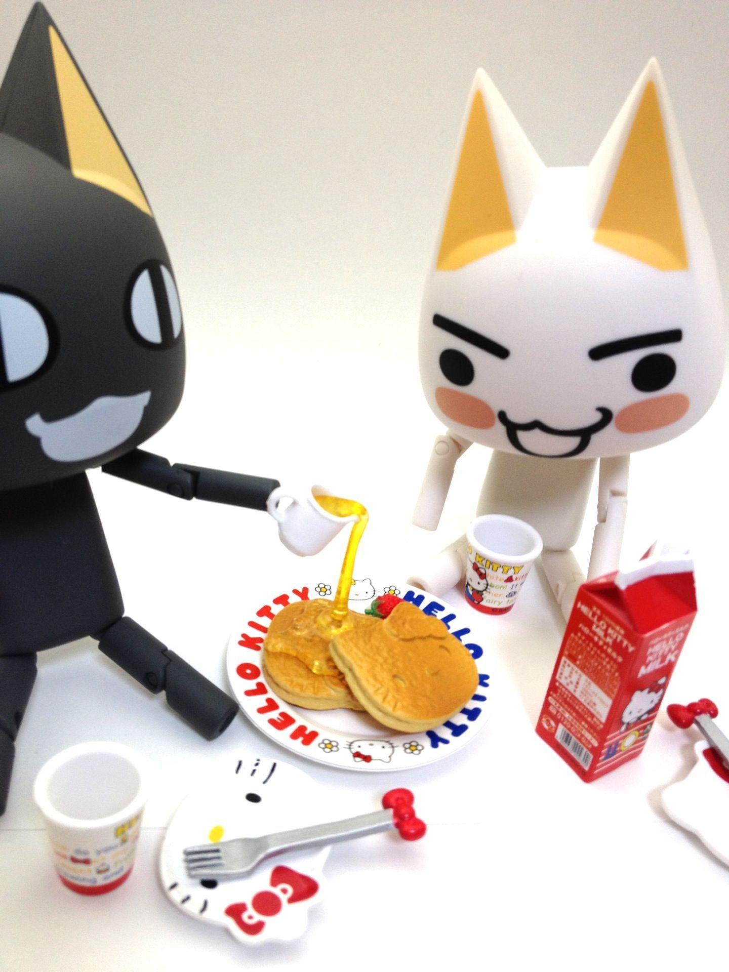 パンケーキを食べようとしているトロとクロです。