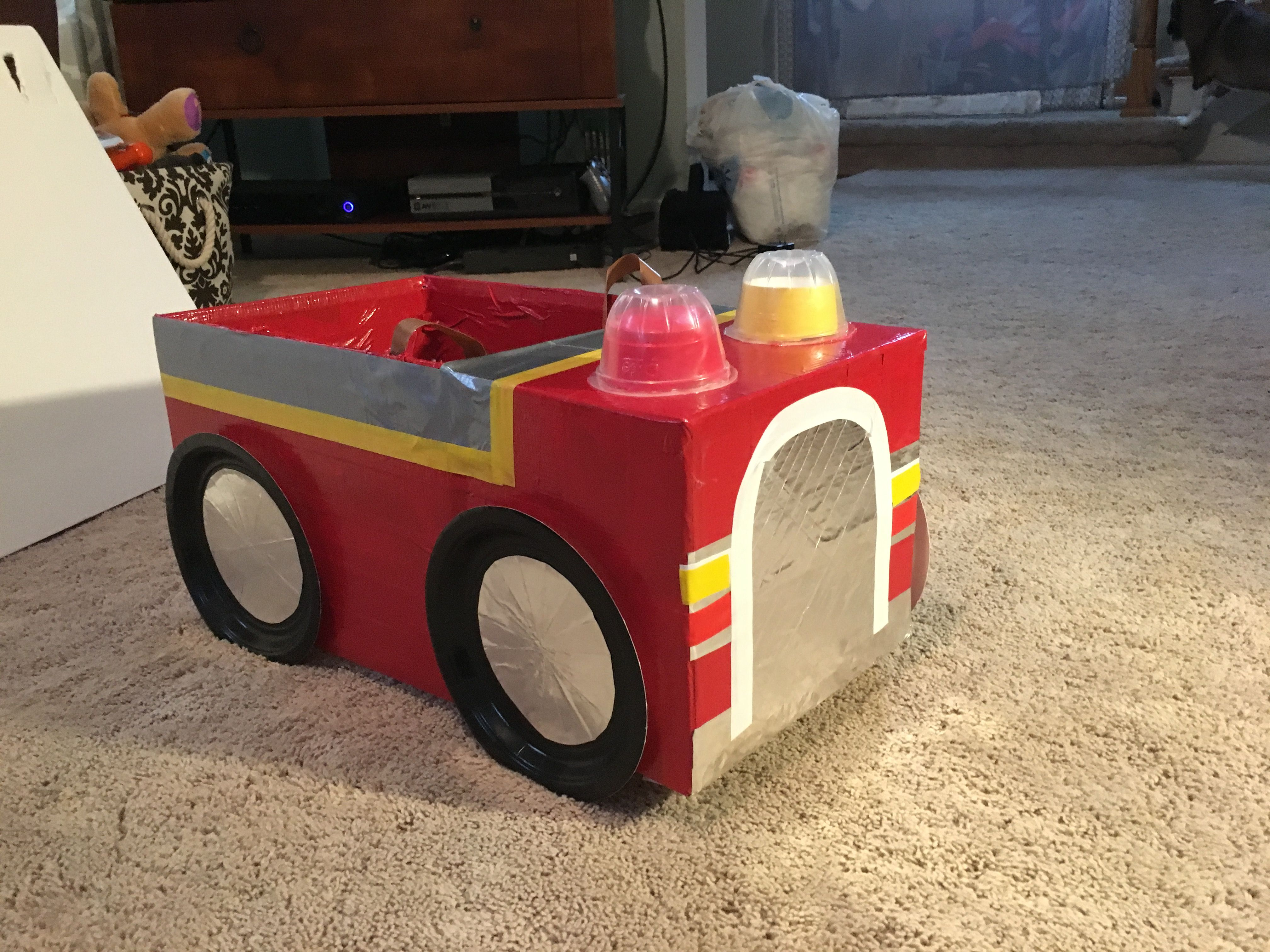 Marshall's fire truck costume! Made out of a diaper box and