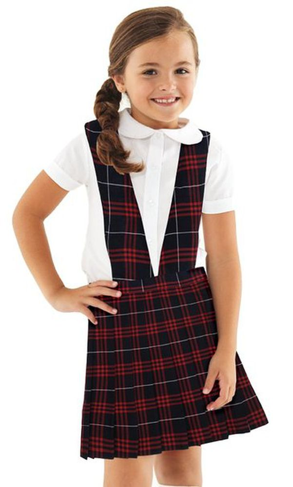 The American Girl Doll Tunic School Uniform is quickly becoming a popular style, with an up to date look. Pleats fall from a square necked yoke. The tunic has a separate belt with 2 button accent. The tunic uniform includes jumper, your choice of top, and scrunchy hair band. Top choices include, white, light blue or yellow blouse, white turtleneck or short sleeve white polo.