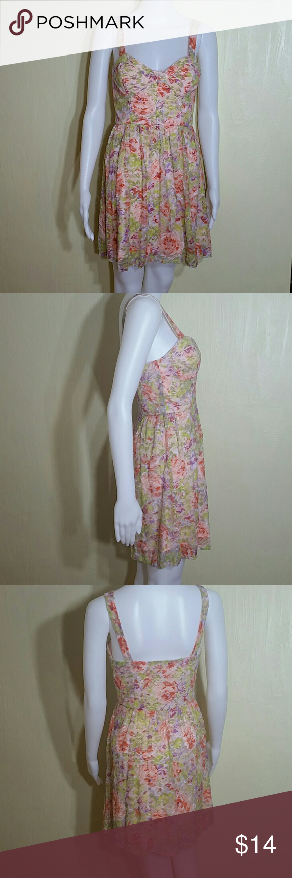 Delias Peach Floral Lace Dress This dresses base color is a soft peach with a floral print of lime green, darker green, purple, and orange splashes of color. This dress is new without tags. It has never been worn. I absolutely love it but it just clashes with my skin tone. delias Dresses