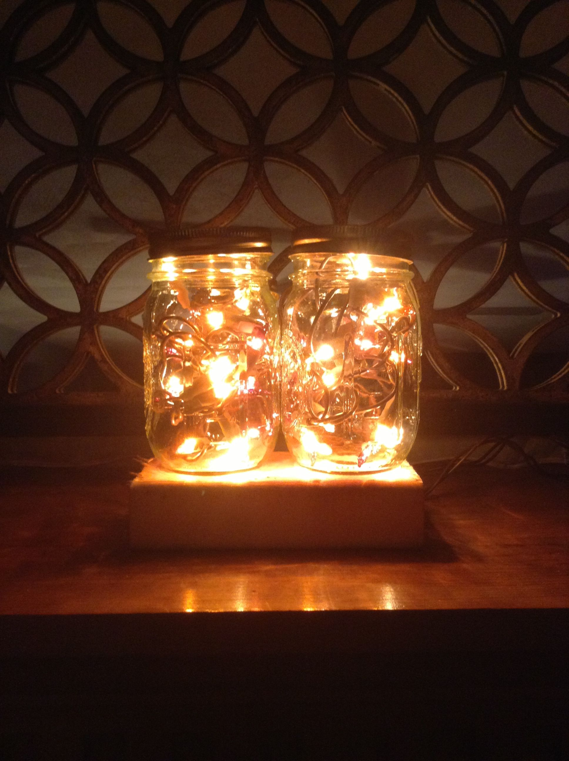 Autumn lights in mason jars. The metal was removed from the tops so the heat can escape.