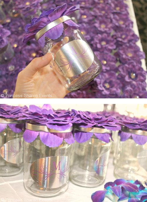 "Every guest got to fill a glass mason jar with candy as a wedding favor. The jars were beautiful! Each one was topped with a silk purple flower and personalized with an ""M"" for Melville."