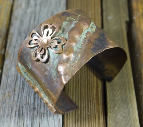 Hammered copper cuff with vintage flower - I loved this one. I hope she makes more.