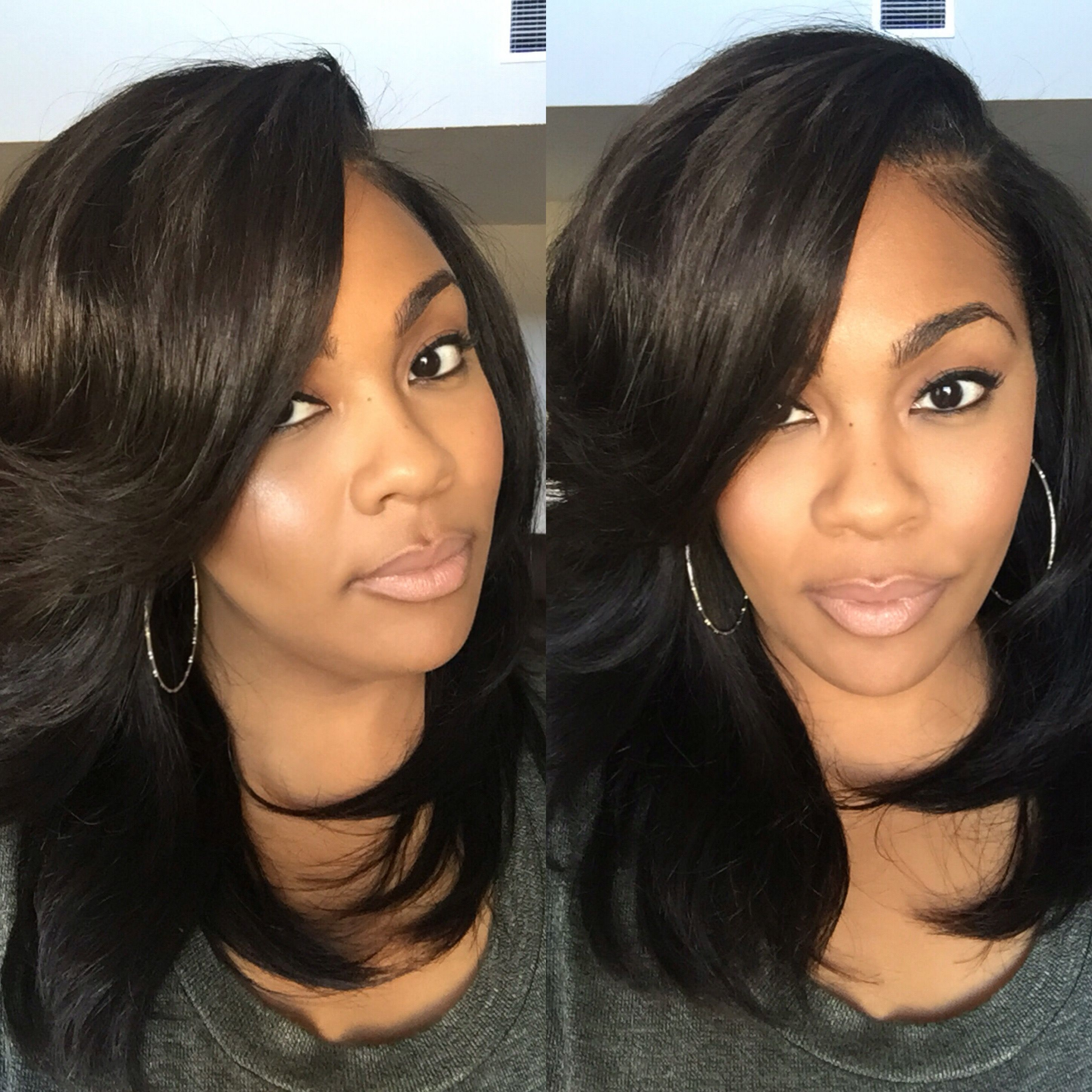 layered sew-in with heavy bangs. hair styled by plushh