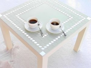 Coffee table with mosaic art and mirror. Lovely! by jimmie