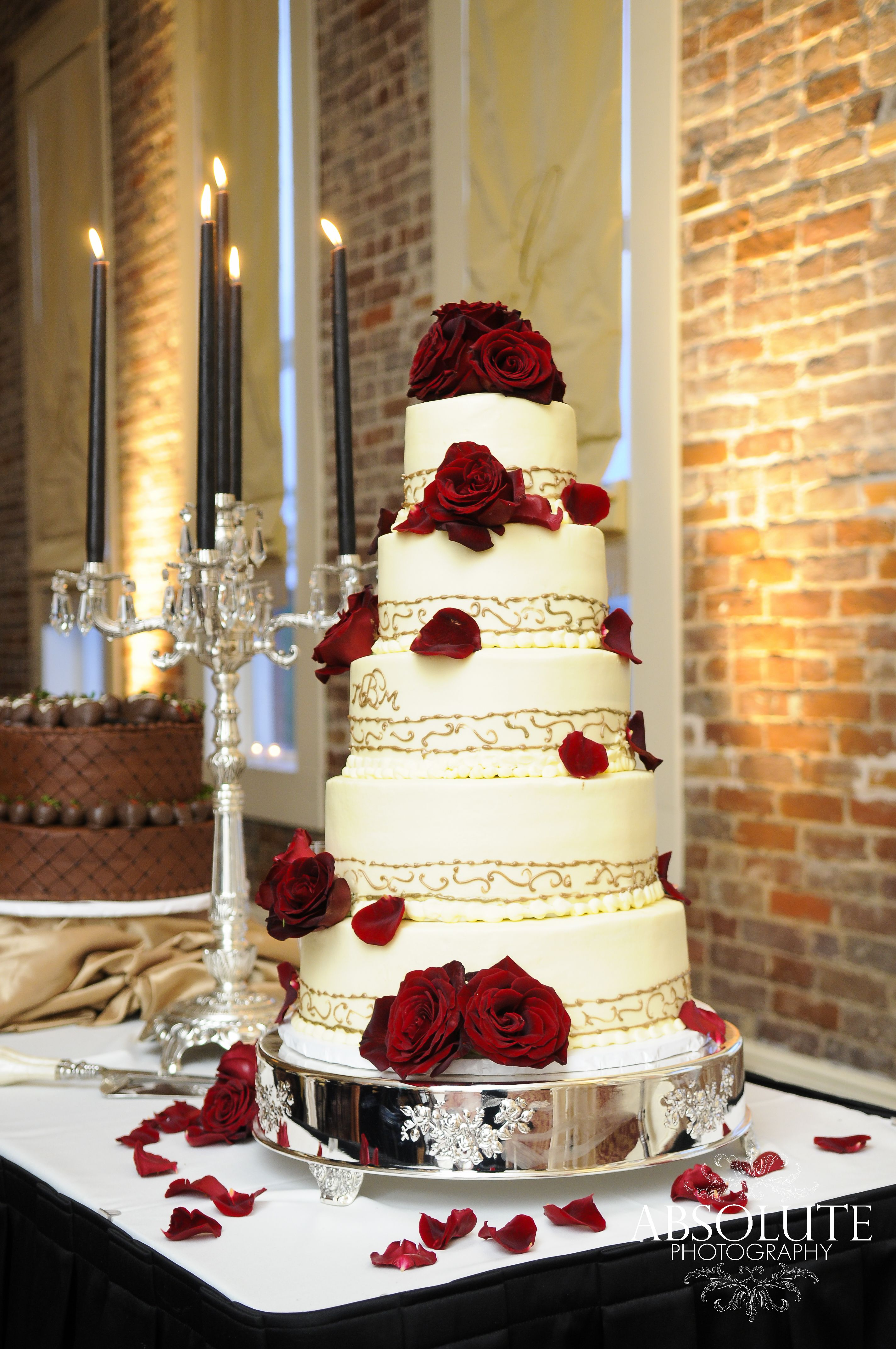Bride And Groom S Cake On The Same Table With Dramatic Decorations And Lighting Hotel Ballroom Wedding Decorations Grooms Cake