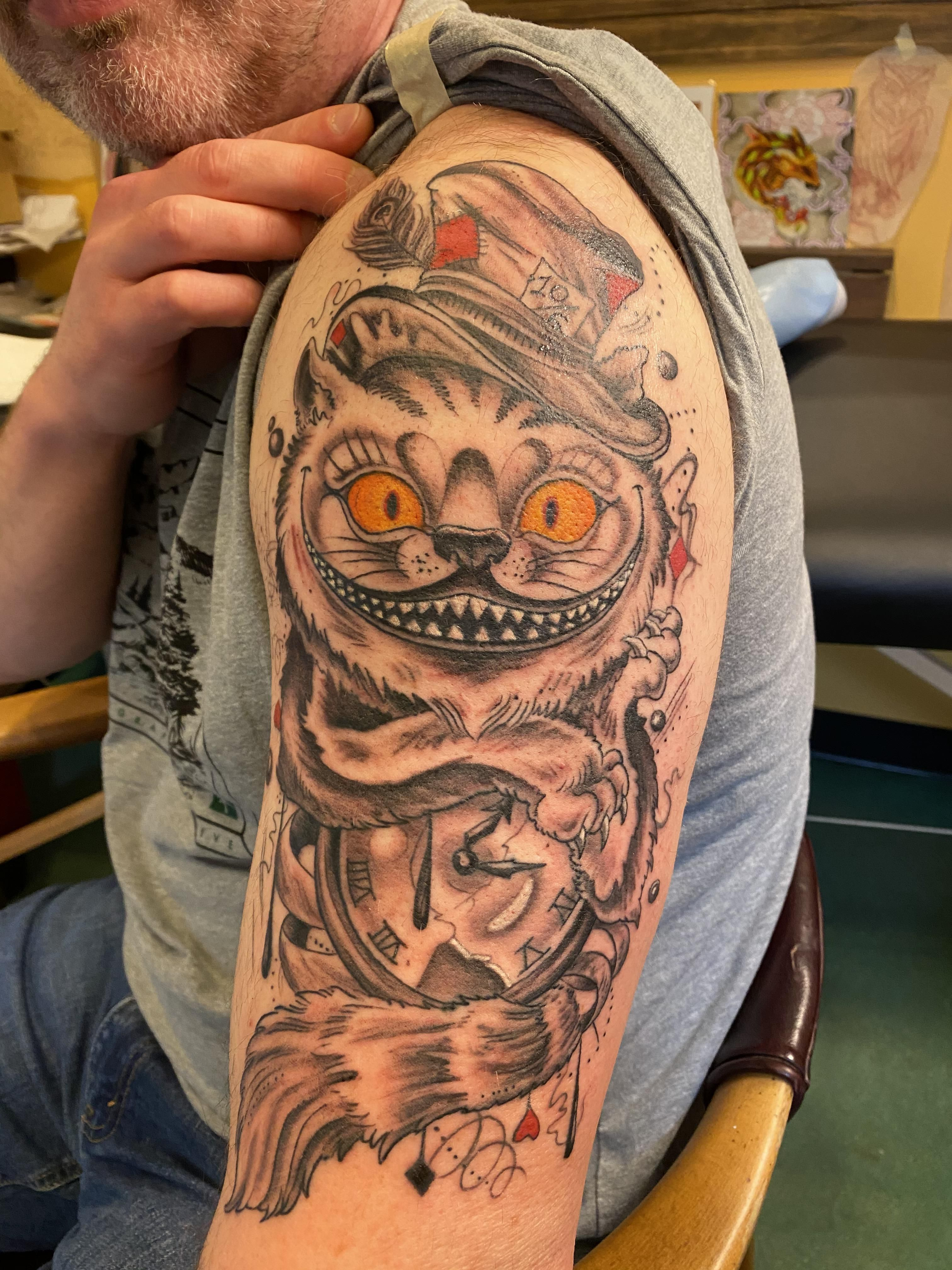 Cheshire cat done by darren at rising tide in boulder co