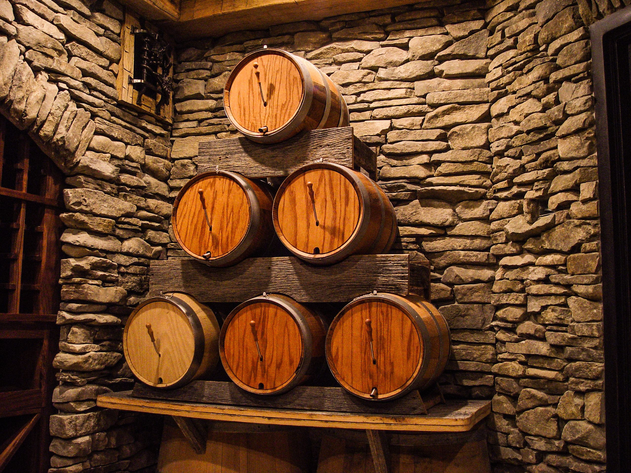 Century old wood, loads of stone, and mini-barrels galore! Cellar by Ron Porter at CellarMaker