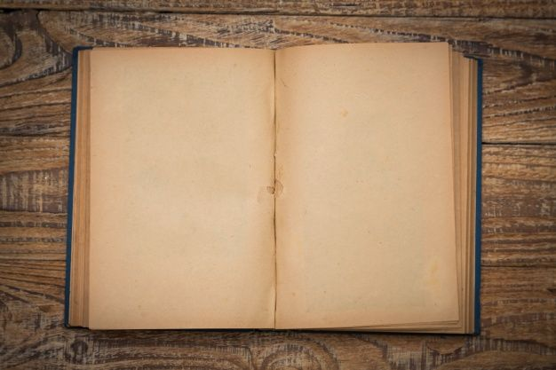 Download Old Book Open On A Wooden Table Seen From Above For Free Book Texture Old Books Open Book