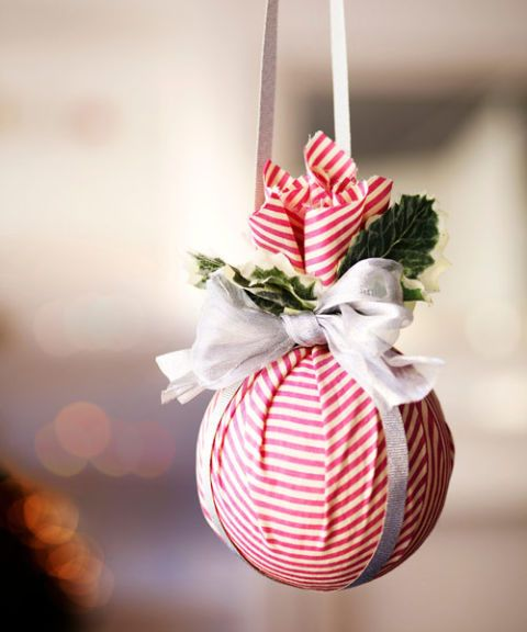 Encourage seasonal smooches with this no-fuss kissing ball. Hide the rubber band with a shimmery bow and festive sprigs.