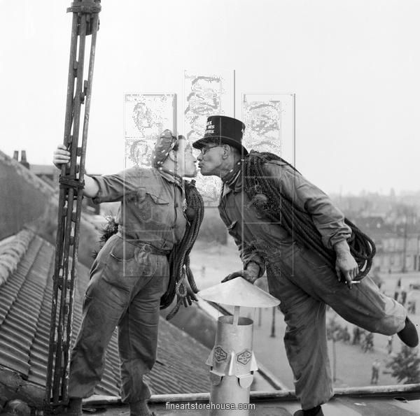 Loving Sweepers kissing on a  Brussels roof top as they sweep chimneys. Canvas Prints from $99.99