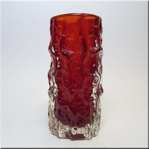 """Whitefriars ruby red glass cylindrical 6"""" 'Bark' vase, from the 'Textured' range, designed by Geoffrey Baxter, pattern number 9689."""