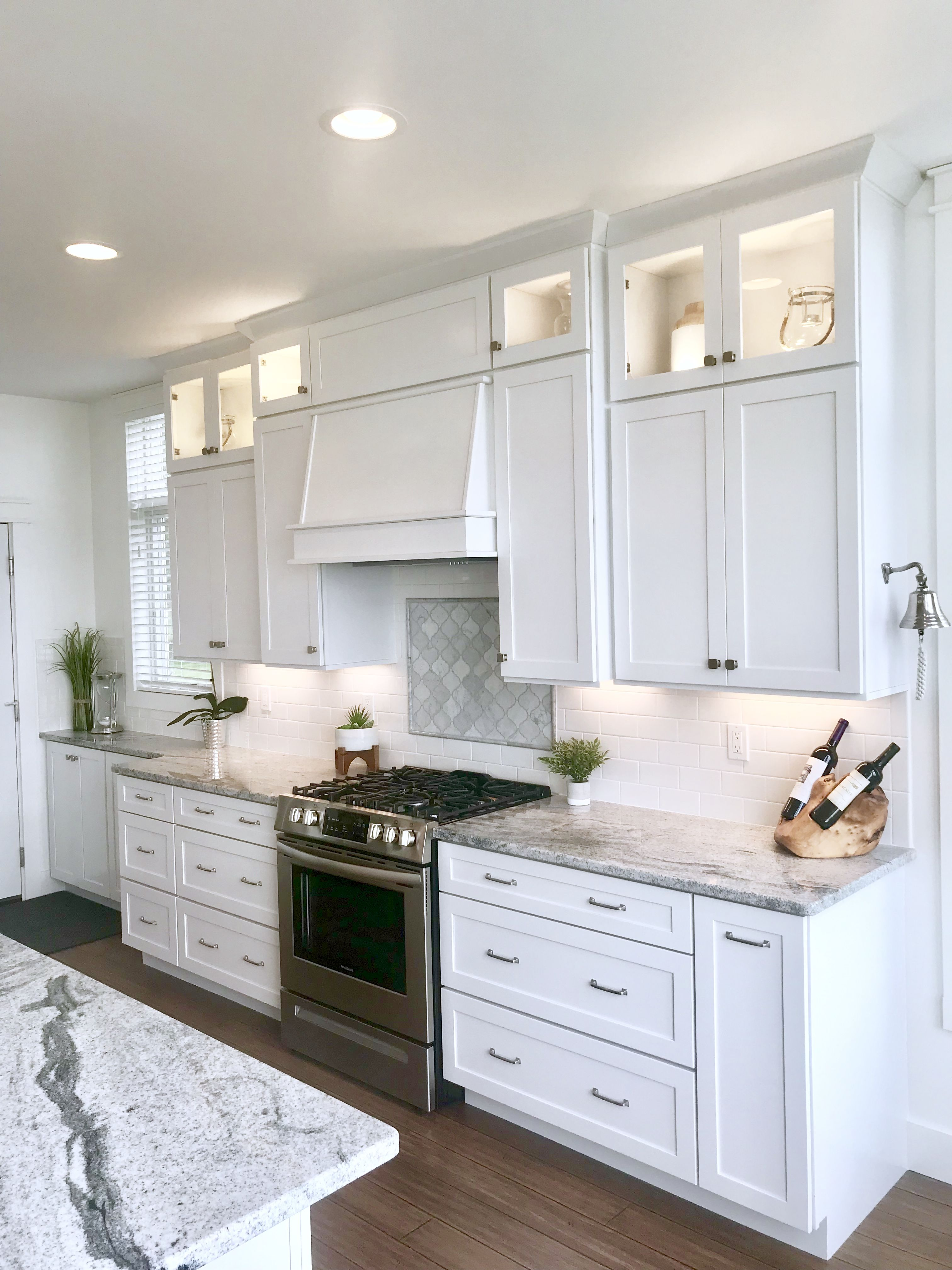 White Kitchen With Bamboo Wood Floor White Shaker Cabinets White Subway Tile With Arabesque Marbl Bamboo Wood Flooring White Shaker Cabinets Shaker Cabinets
