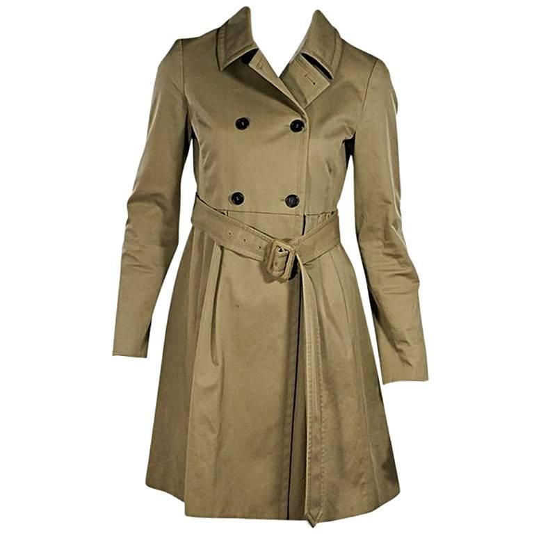 1e5cbd7c1d5c For Sale on 1stdibs - Product details  Khaki gabardine trench coat by Miu  Miu. Spread collar. Long sleeves. Double-breasted button closure.