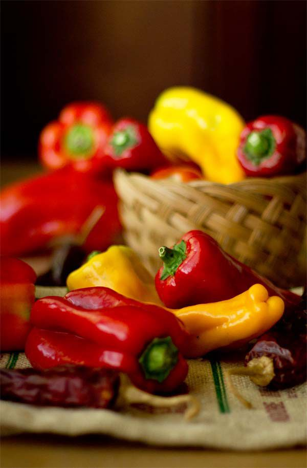 An assortment of sweet peppers and red chile peppers, used to make a
