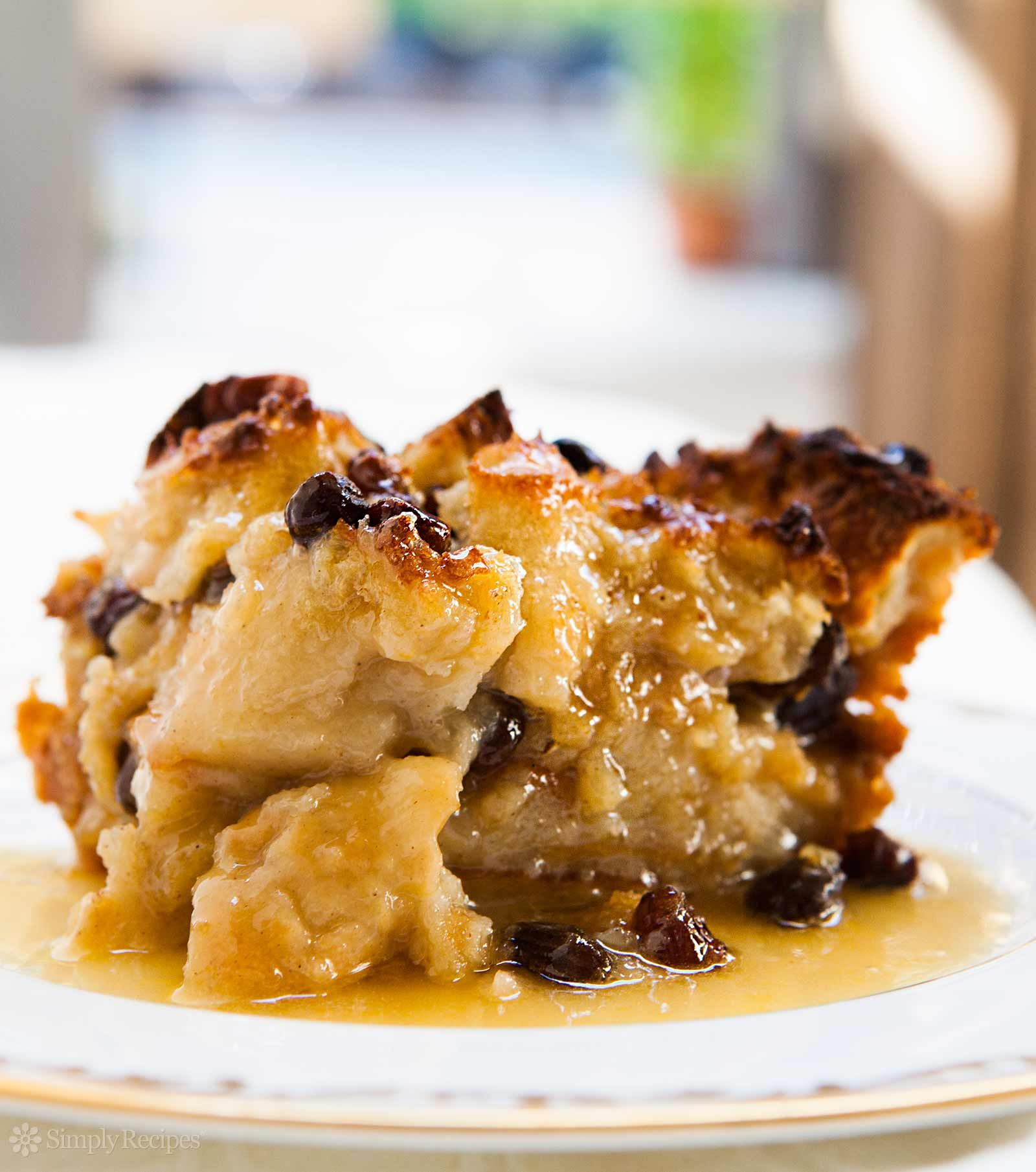 Authentic New Orleans Bread Pudding! With French bread, milk, eggs, sugar, vanilla, spices, and served with a Bourbon sauce. On SimplyRecipes.com