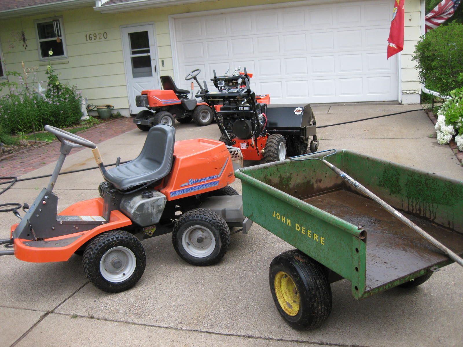 The yard tractor Husqvarna 970 and original JD 80 cart Mowers